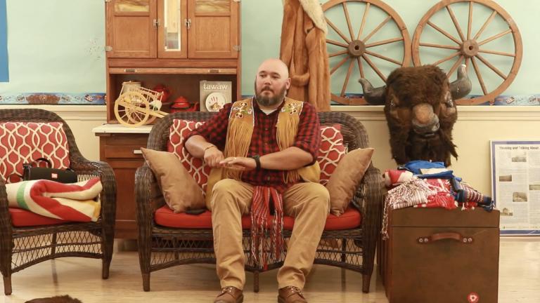 Métis man playing spoons
