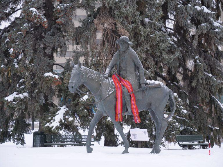 Louis Riel statue with sash